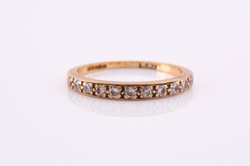 Lot 100A - An 18ct yellow gold band ring, pave-set with...