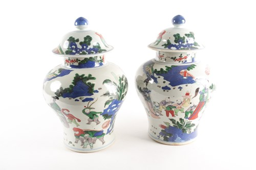 Lot 267 - A pair of Chinese Wucai vases and covers, Qing,...