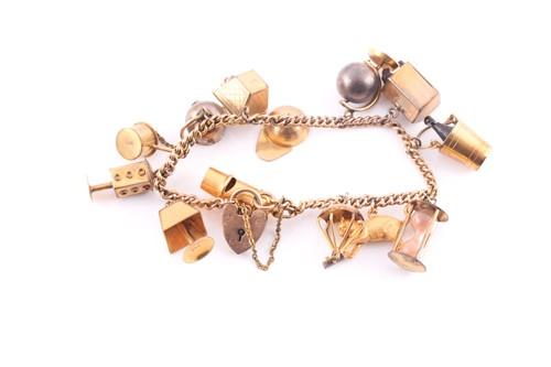Lot 1 - A charm bracelet; the 9 carat gold curb...