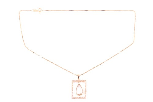 Lot 20 - A citrine and diamond pendant; the pear shaped...