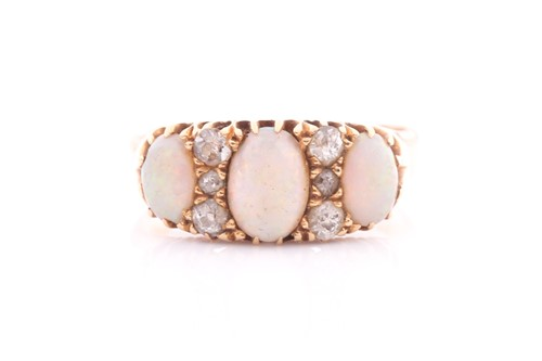 Lot 8 - An Edwardian opal and diamond ring; the three...