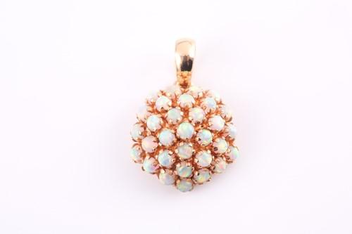 Lot 9 - An opal cluster pendant, the circular bombé...