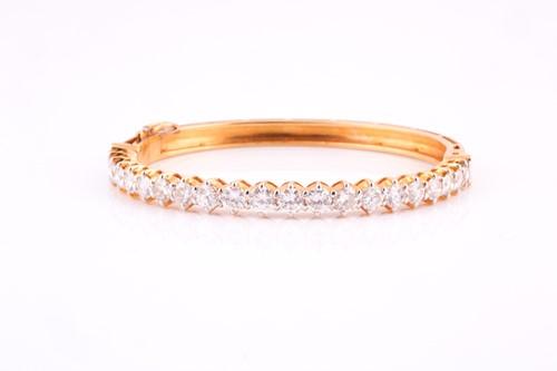 Lot 48 - A diamond bangle; the centre set with twenty...