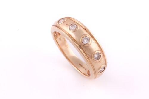 Lot 11 - A five stone half hoop diamond ring; the...