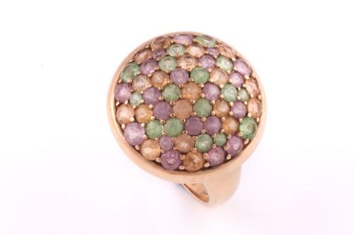 Lot 4 - A multi gem-set dress ring; the domed cluster...