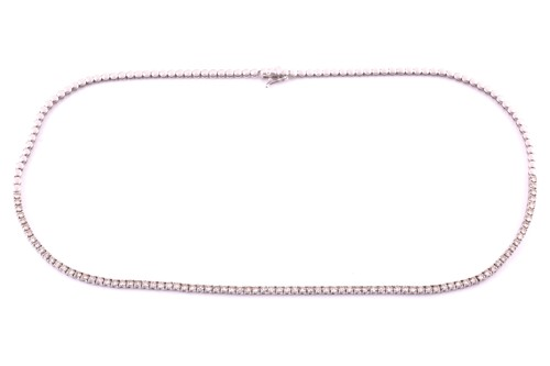 Lot 11 - An 18ct white gold and diamond line necklace,...