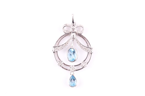 Lot 13 - A diamond and blue topaz drop pendant, in the...