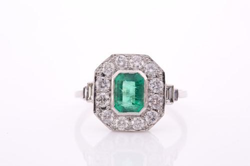 Lot 17 - A platinum, diamond, and emerald ring, set...
