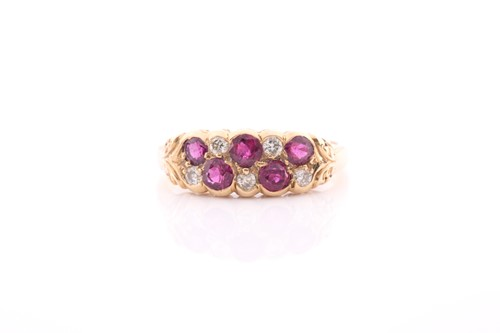 Lot 14 - An 18ct yellow gold, diamond, and ruby ring,...