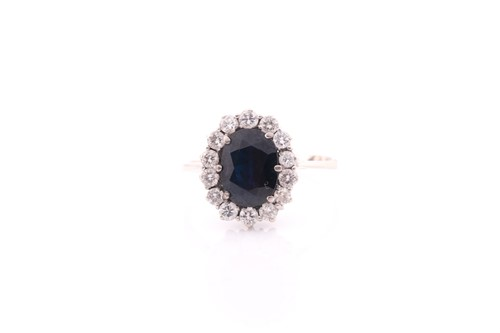 Lot 6 - A white metal and sapphire cluster ring, set...