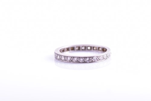 Lot 40 - A platinum and diamond eternity ring, set with...