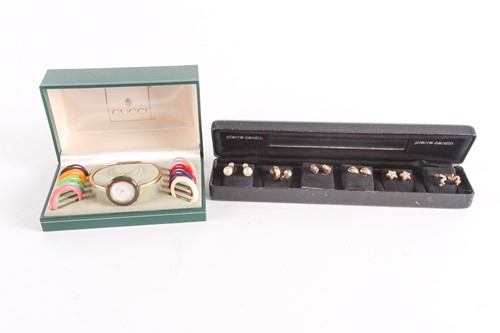 Lot 25 - A Gucci lady's gold plated watch with quartz...