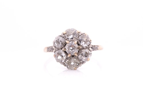 Lot 68 - A platinum and diamond daisy cluster ring, set...