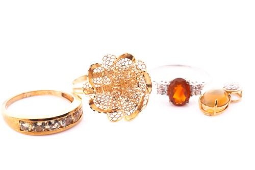 Lot 32 - A 9ct yellow gold and pale yellow gemstone...