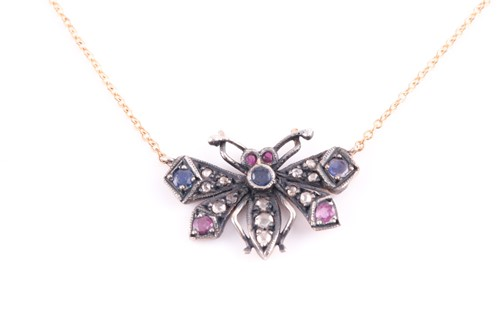 Lot 61 - A diamond and gemstone butterfly pendant, the...