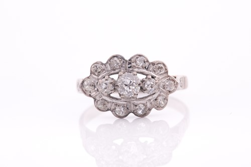 Lot 52 - An 18ct white gold and diamond ring, set with...