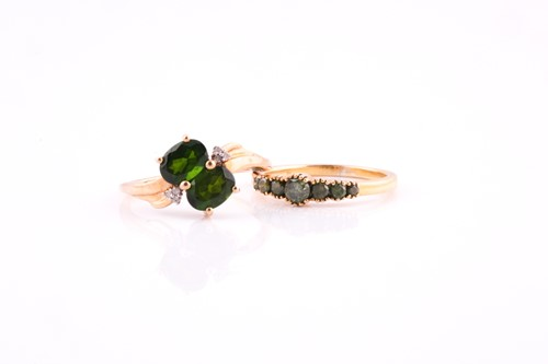 Lot 57 - A two stone chrome diopside cross-over ring...