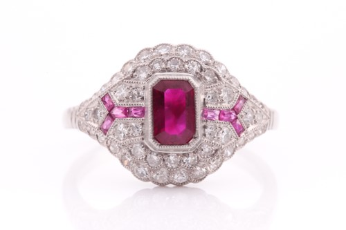 Lot 67 - An Art Deco diamond and ruby ring, inset with...