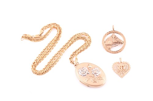 Lot 1 - A two colour 9 carat gold oval locket; with...