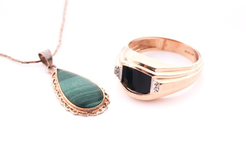 Lot 2 - A gents yellow metal and onyx ring, set with a...