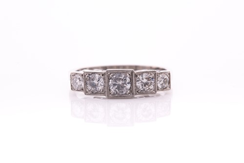 Lot 13 - A platinum and diamond ring, the five...