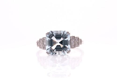 Lot 34 - A platinum, diamond, and aquamarine ring, set...