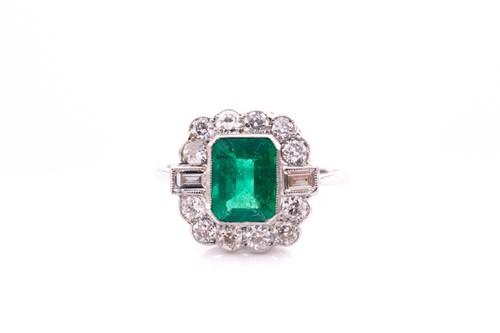 Lot 69 - A platinum, diamond, and emerald ring, set...
