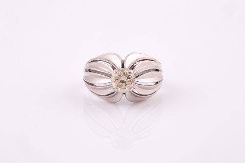 Lot 5 - A 1950's solitaire diamond ring, set in white...