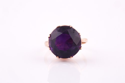 Lot 9 - A 1960's amethyst solitaire ring, the round...