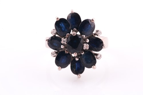 Lot 47 - A 1970's sapphire and diamond cluster ring,...