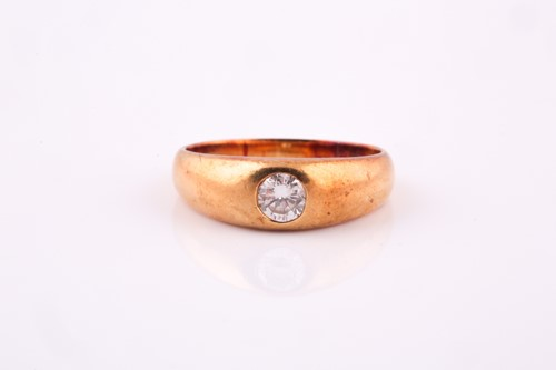 Lot 28 - A yellow metal and diamond ring, set with a...