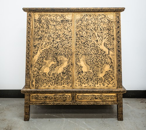 Lot 46 - A Tibetan inverted tapering lacquered cabinet,...