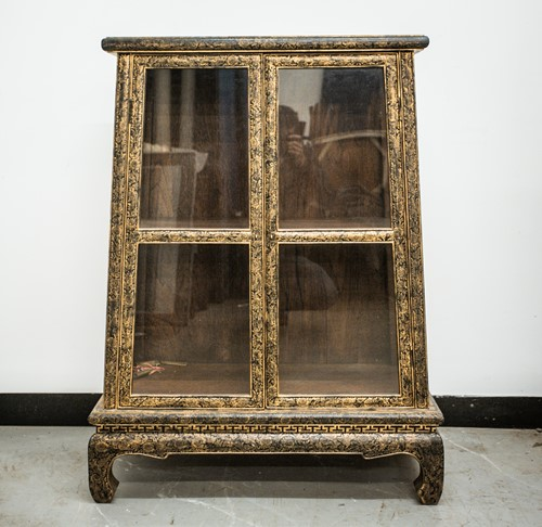 Lot 35 - A Tibetan lacquered and gilt decorated display...