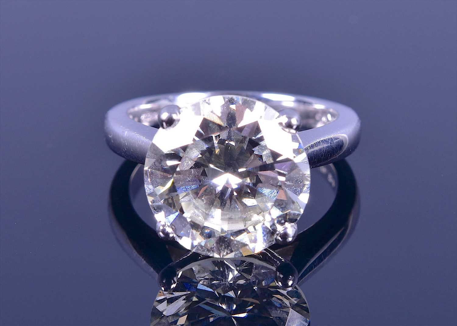 Lot 555-An impressive 18ct white gold and solitaire...