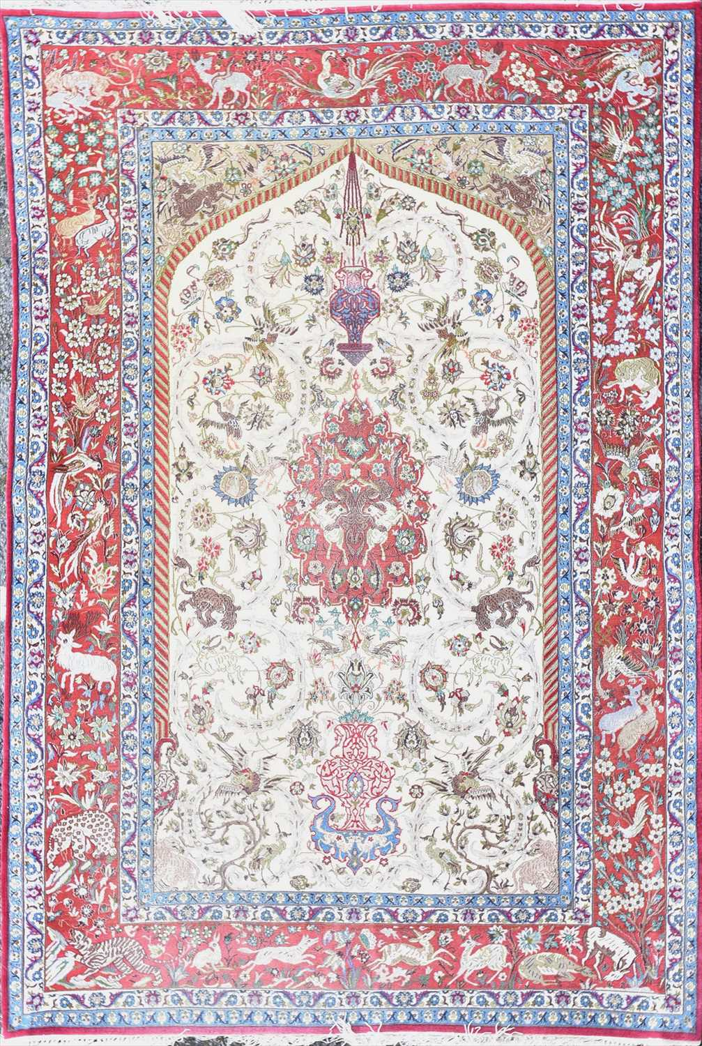 Lot 47-A Persian red and cream ground rug polychrome...