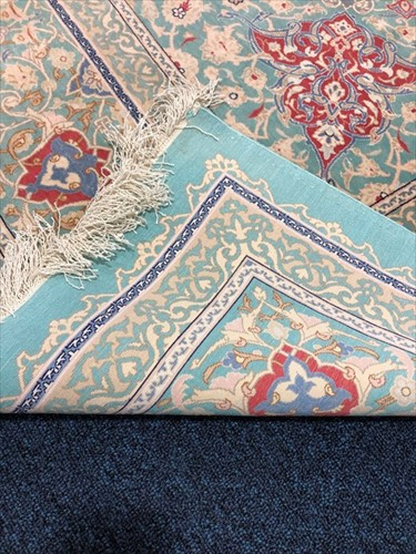 Lot 69 - A large hand woven silk Nain rug with central...